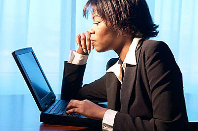 Woman using laptop uid 1344248